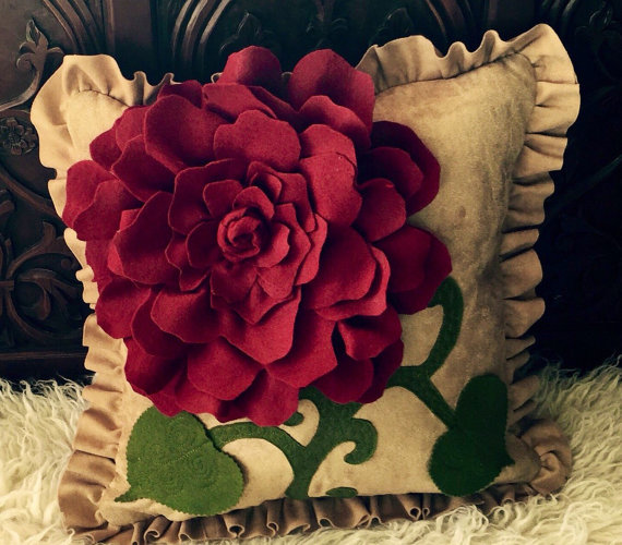 Red felt rose pillow by StatementMArcangel - the leaves and rose reminded me of the Sleeping Beauty (1959)