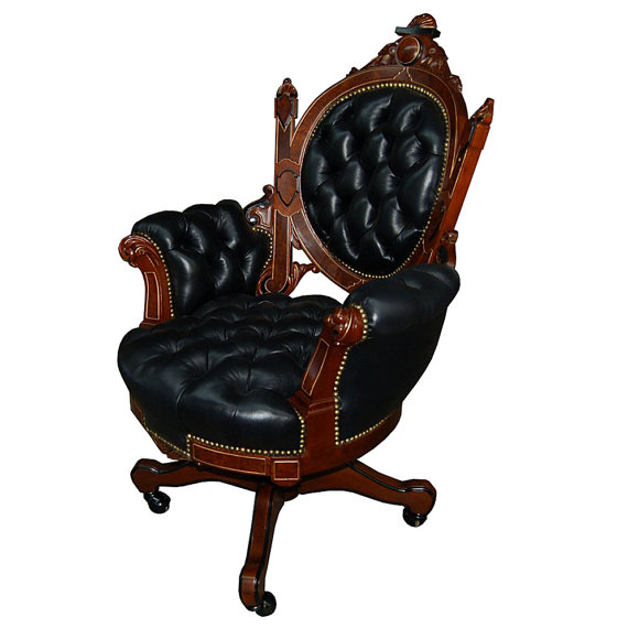Black leather chair by Antiquarian Traders